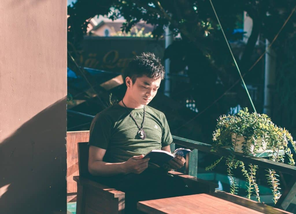 man reading Photo by Zun Zun