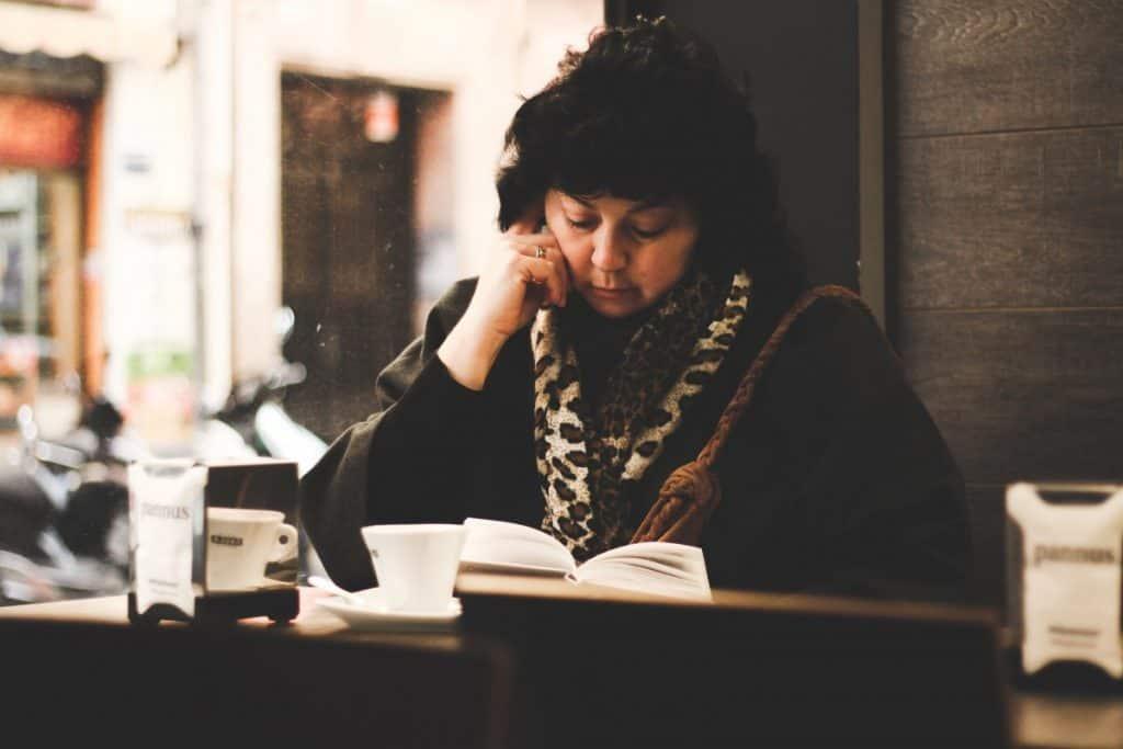 Woman reading Photo by Roman Carey